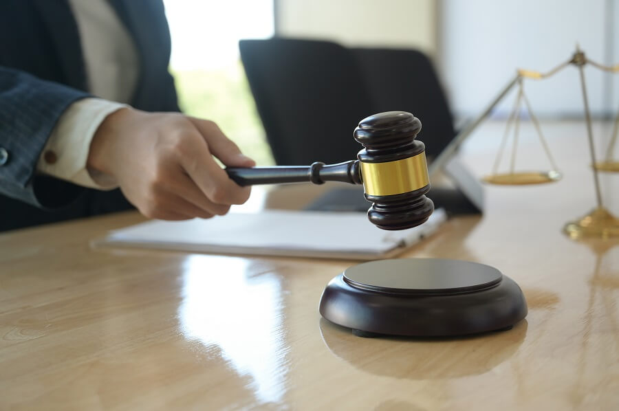 concept-of-justice-lawyer-holding-a-hammer-pretend-BWTAJ76 (1)