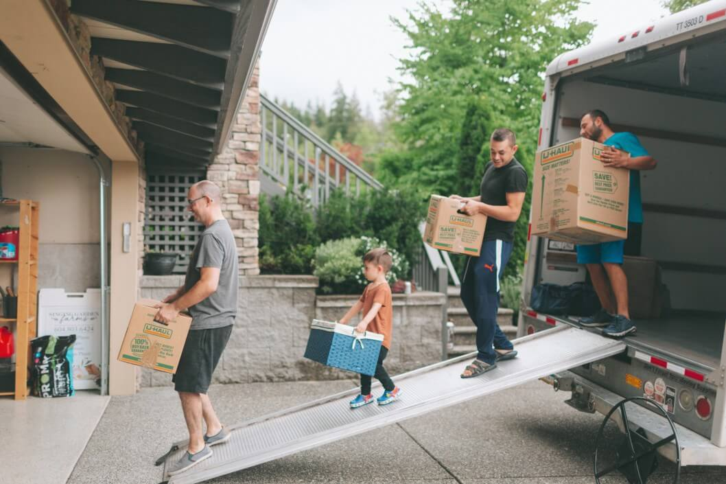 men-family-home-moving-boxes-moving-truck_t20_eoaVaa (1)