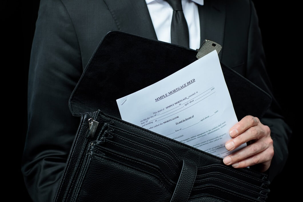 mid-section-of-businessman-in-suit-holding-briefca-KHMF9ZB (1)